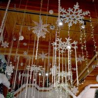 Snowflakes and twinkling lights hang from the ceiling ...