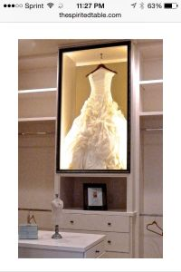 Wedding dress shadow box in closet
