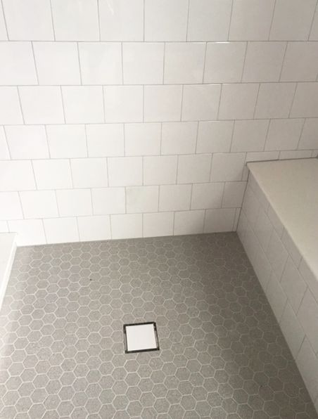6x6 Offset White Wall Tile with Gray Hexagon Mosaic Floor