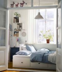 Tiny bedroom- bed turned sideways against wall with ...