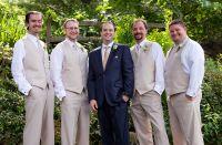 Groomsmen - Groom in navy suit with champagne tie ...