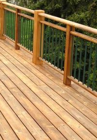 Traditional red cedar paired with metal balusters and a ...