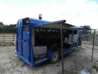 A converted horse trailer and propane tank make a rustic ...