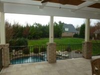 Open Porch with brick columns and a Travertine stone floor
