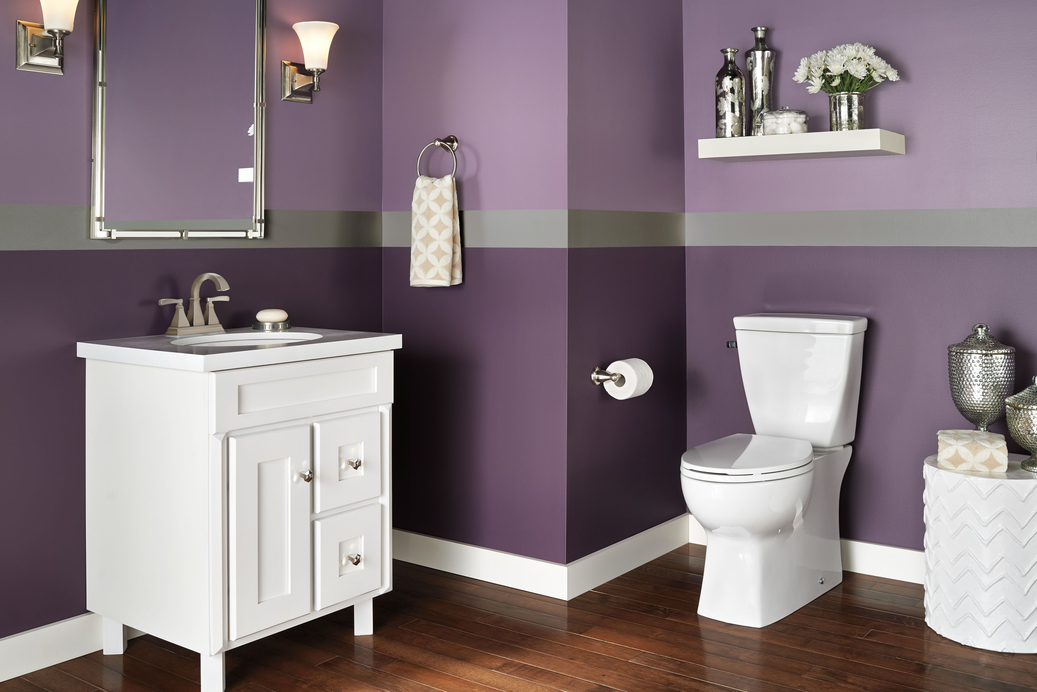 Purple paint in the bathroom adds drama to the subtle