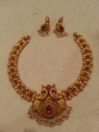Antique bridal necklace and earrings. Peacock design