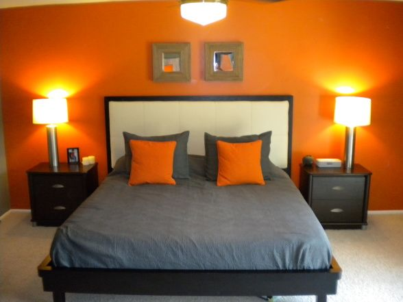 sunset orange for accent wall bedroom I love this. The one orange accent wall brings up the