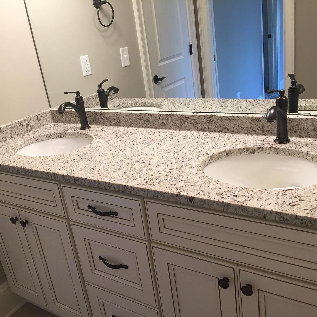 contemporary full bathroom with giallo napoleone, granite by