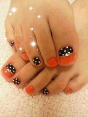orange black and white poka dots