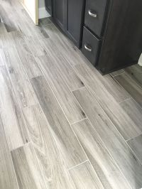 Newly installed gray weathered wood plank tile flooring ...