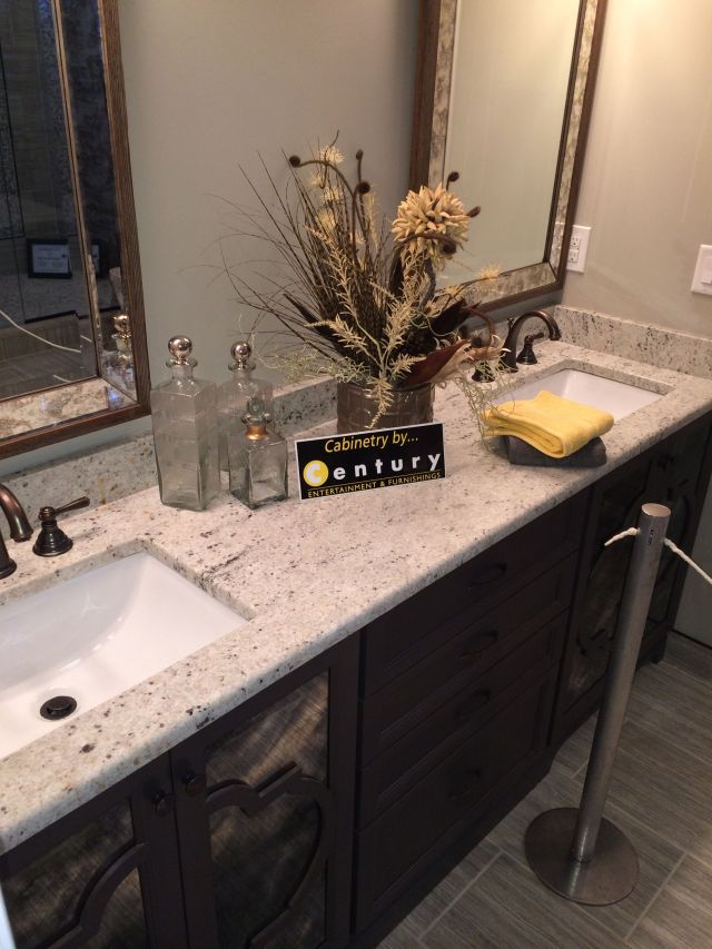 Colonial White granite with dark vanity Visit globalgranite