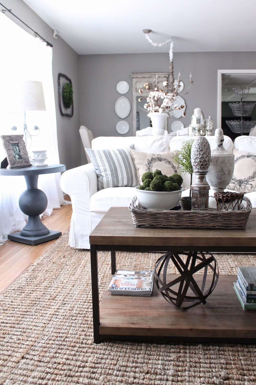 grey sofa black table mayo conversational living room walls and furnishings white couch
