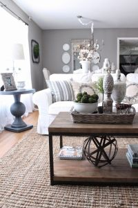 Living room: Grey walls and furnishings, white couch ...