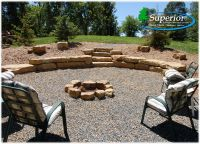 Natural fire pit area with limestone walls and crushed ...