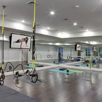Bat Gym With Mirrored Walls And Wood Floors
