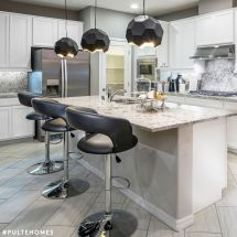 Black Leather Stools And Bold Geometric Light Fixtures