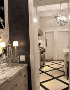 Calcutta marble counter tops black walls limestone tiles floor white cabinets sphere chandelier diamond patterned subway back splash also calacatta panels design pictures remodel decor and ideas rh pinterest