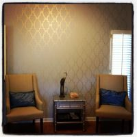 Stenciled accent wall with metallic gold paint. Wonder if ...