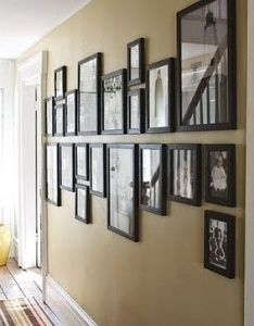Hanging family photos design pictures remodel decor and ideas wall ideashallway ideasframes also rh pinterest