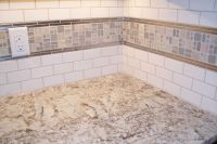 small subway tile with mosaic border and stainless steel ...