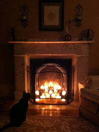 Decorated my non-working fireplace with candles. | For the ...
