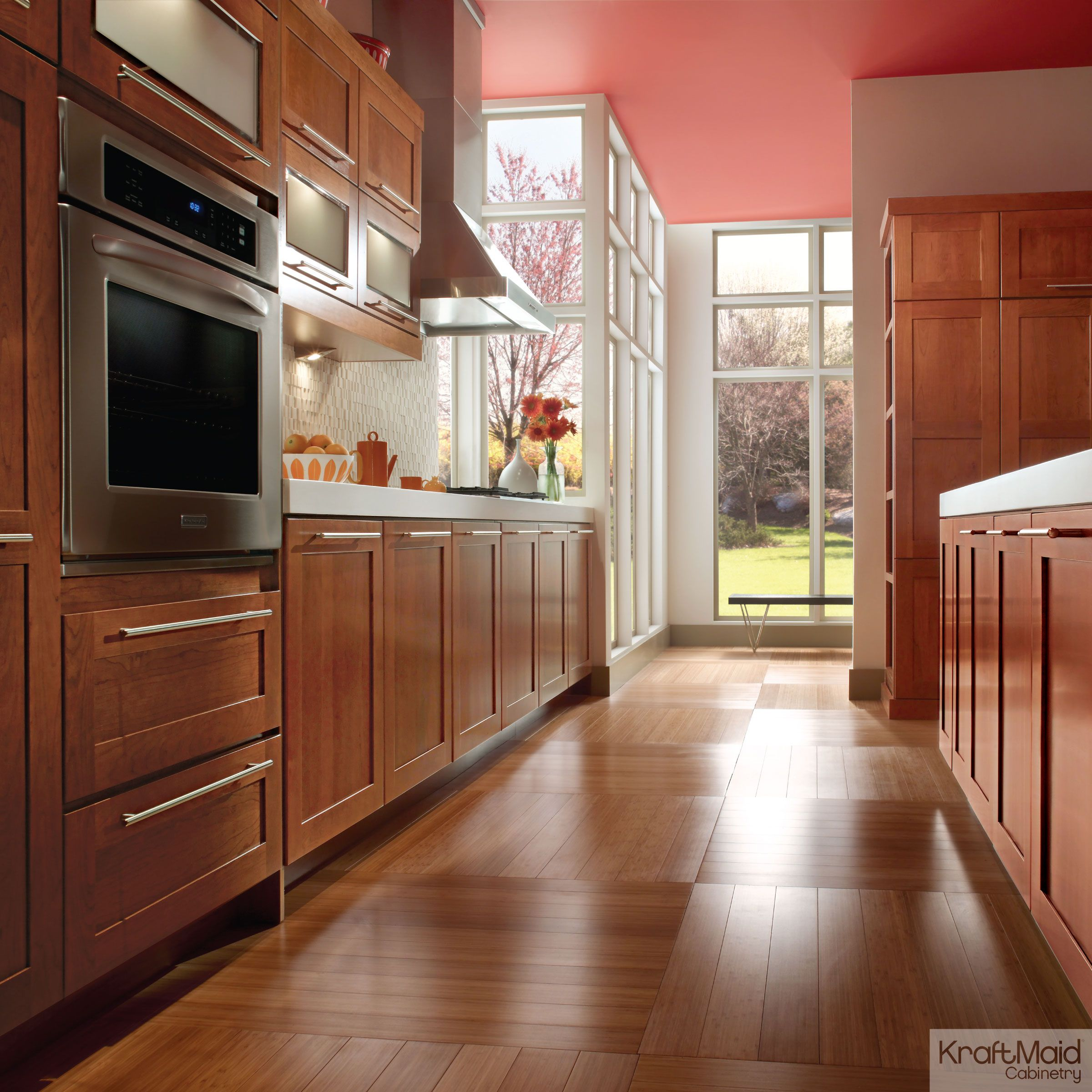 kraftmaid kitchens gallery kitchen table with built in bench cherry cabinetry kraftmaids cinnamon stain adds warmth
