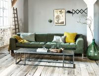 Industrial living room with pops of green and yellow and a ...