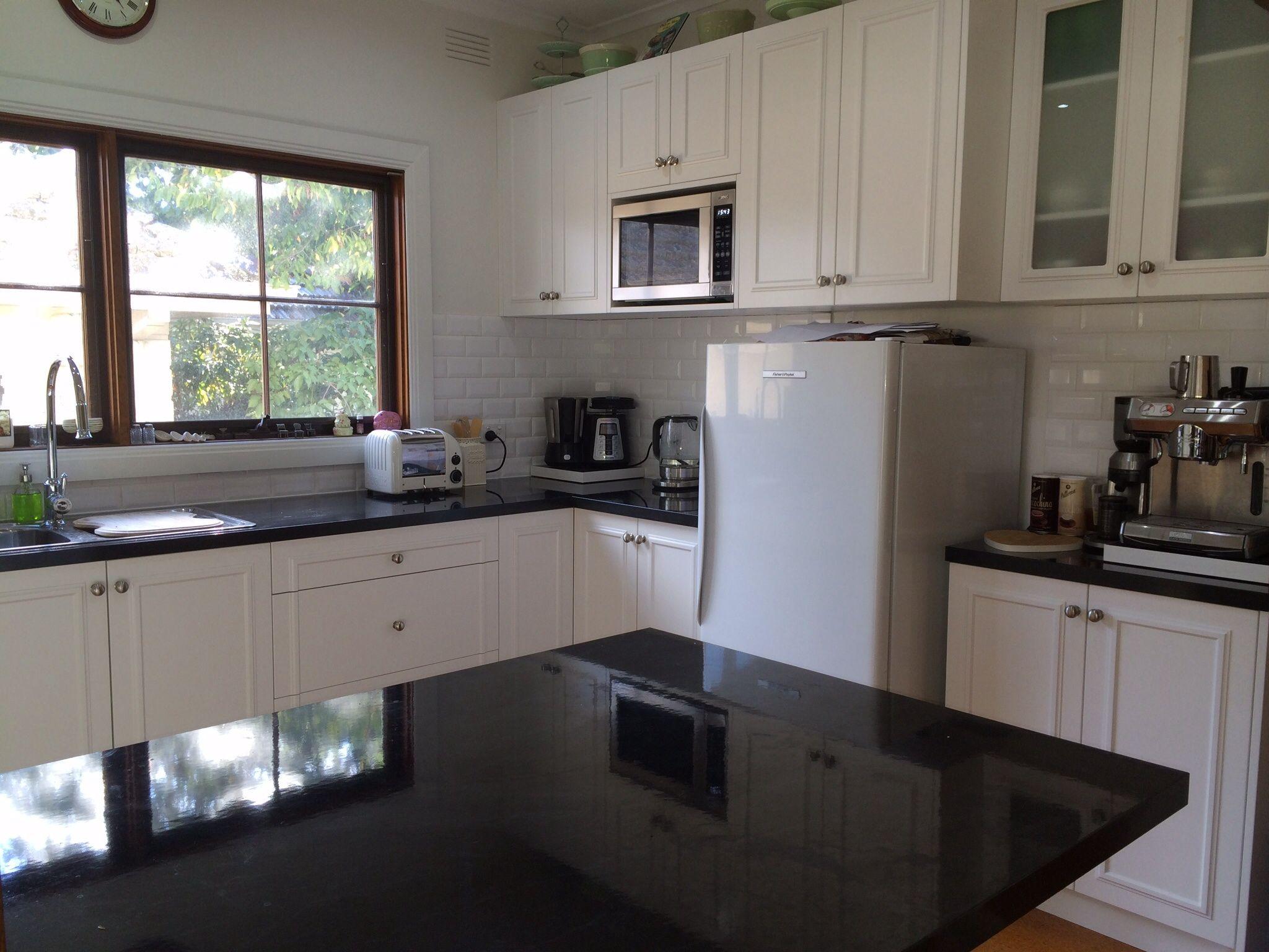 black subway tile kitchen granite counter tops finished result with white splash back