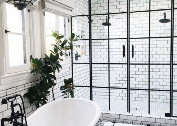 Subway tiles with dark grout and ornate medallion floor set the stage accentuated by windowpane shower doors black trim also white home life pinterest
