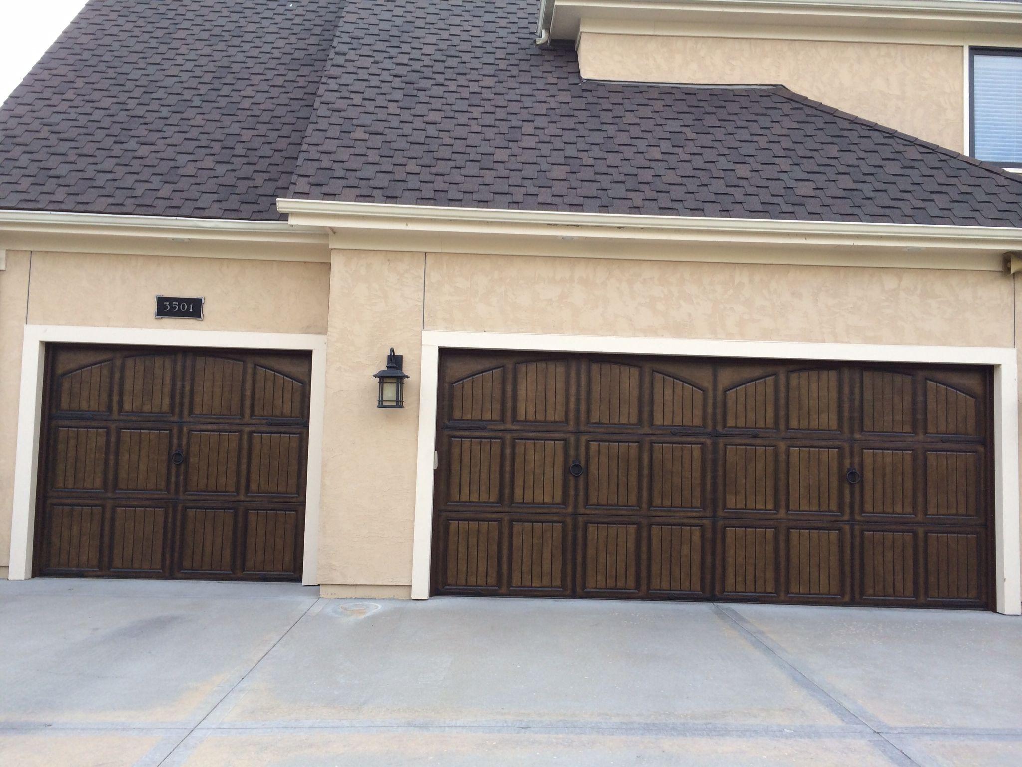 Triple garage door with decorative hinges, Coastal Bronze