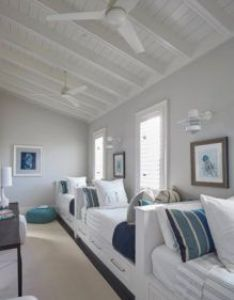 Beach house features  boys  bedroom filled with row of white built in beds fitted storage drawers dressed and blue striped bedding also bunk room interiors houses coastal nautical ideas rh pinterest