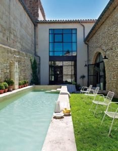 Wonderful old oil mill restored into  modern house with natural stone floor wall big window chair and outdoor also located in the south of france this property was converted from rh pinterest
