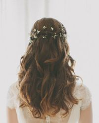 wedding hair waterfall braid baby's breath
