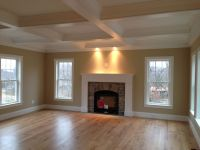 Coffered ceiling and custom wood mantle. Stone fireplace