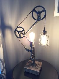 Industrial gas pipe and pulleys with Edison bulbs, cotton