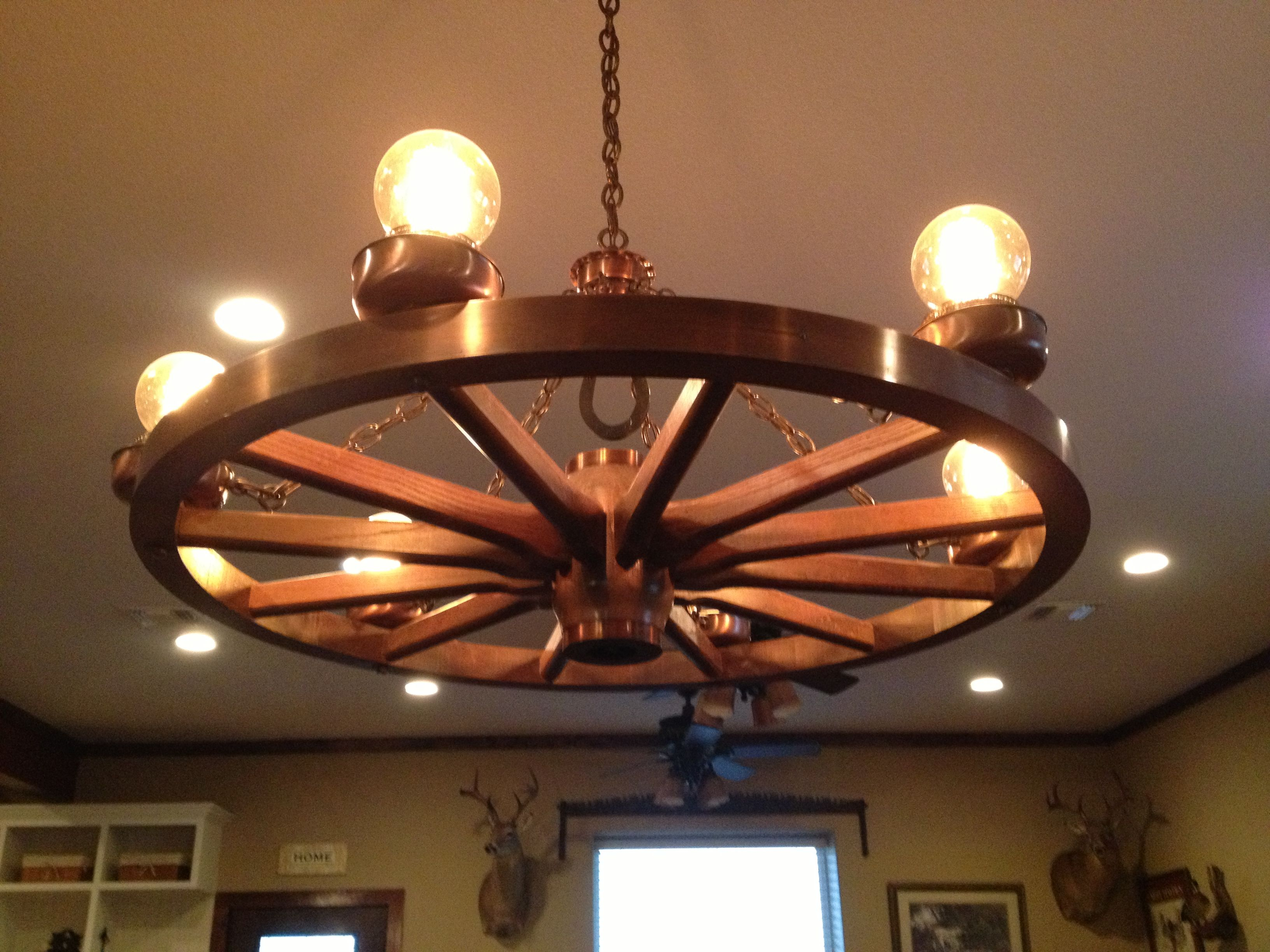 Wagon wheel chandelier with antique light bulbs  My