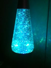 its a glitter lava lamp it changes 3 colors red,blue,and ...