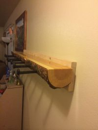 Log coat rack with railroad spike hangers.