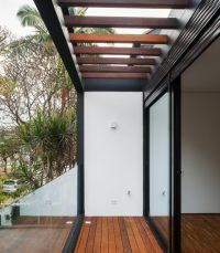 Wooden Pergola And Sliding Glass Panel Also Dark Steel