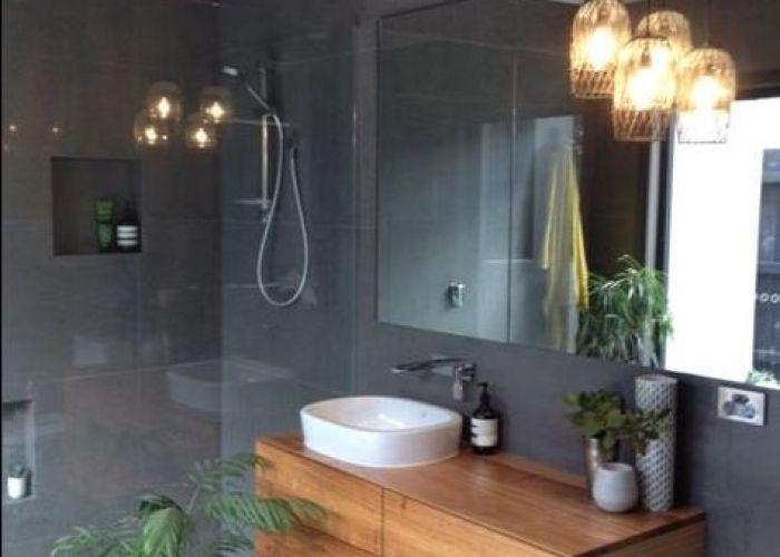 Timber vanity unit in  dark tiled bathroom also wohnen pinterest