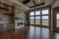 Great room with ceiling high stone fireplace, built-in ...