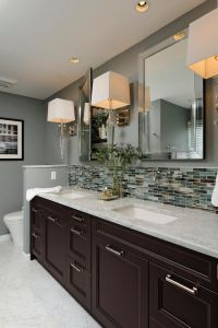 This gray contemporary bathroom features a double-vanity ...