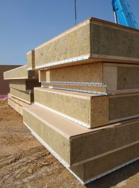 The prefabricated panels are somewhat similar to SIPs ...
