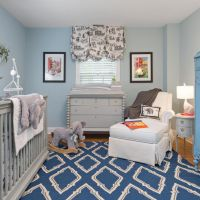 Light blue walls are a classic touch to this baby boy's ...