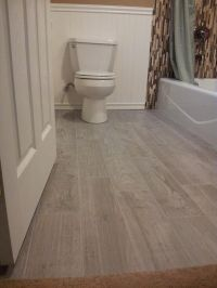 Planked porcelain wood like tiled floor | Bathroom Floor ...
