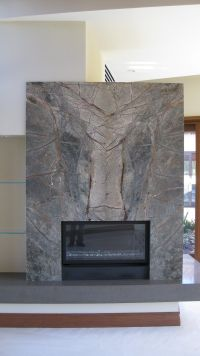 Book matched stone fireplace wall and slab stone hearth ...