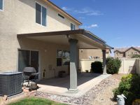 Here's an insulated patio cover with stucco columns. The ...