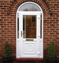 A uPVC front door with arched window above | uPVC Doors ...