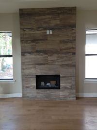 J Wood Tile makes an absolutely stunning fireplace ...