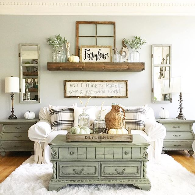 Coffee table shelf couch  symmetrical very soothing arrangement living room wall decor ideas above also rh in pinterest